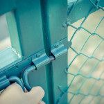 Chain link fence coatings protect gates & fence and add color