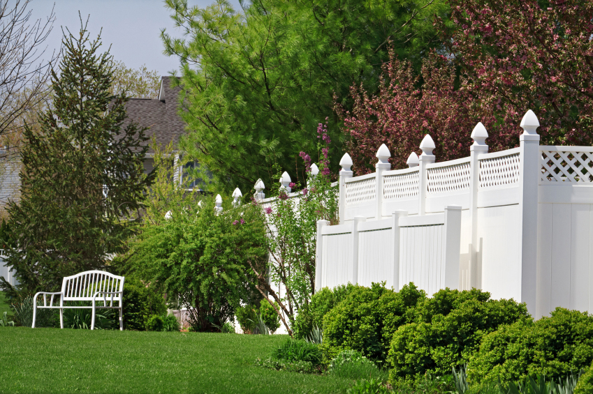 Tall luxury home fence installed around property