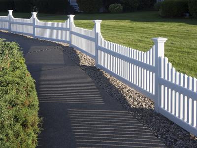 Vinyl fencing installed around open pasture & walkway