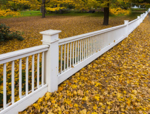 white post fence provides decorative barrier