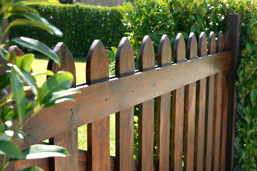 Wood garden fencing installed for backyard privacy